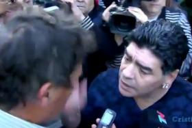 Screenshot from a video showing Diego Maradona slapping an Argentine journalist.