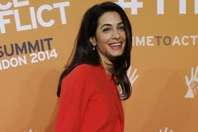 Barrister Amal Alamuddin, fiancee of actor George Clooney, attends a summit to end sexual violence in conflict at the Excel centre in London June 12, 2014.