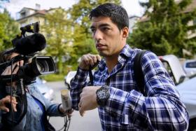 Luis Suarez arrives at the Court of Arbitration for Sport in Lausanne, Switzerland to appeal against his ban for biting Giorgio Chiellini at the 2014 World Cup.