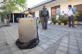 The body of a woman was found inside this suitcase, displayed at a police station in Nusa Dua on the Indonesian resort island of Bali.
