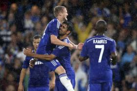 Diego Costa (second from right) celebrates with Andre Schurrle after scoring Chelsea's second goal against Real Sociedad.