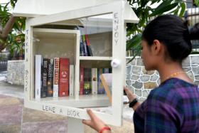 Some of the books in Mr Bryan Lim's mini library at 81 Woskel Road, with familiar books such as the Lord of The Rings books and books by Nicholas Sparks.