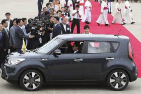 """Pope Francis in his latest """"popemobile"""", a Kia Soul. The pope is currently in South Korea."""