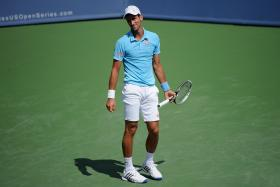 Tommy Robredo shocked world number one Novak Djokovic 7-6(6) 7-5 on Thursday to move into the quarter-finals of the Western and Southern Open in Cincinnati.