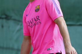 The Uruguayan striker was the centre of attention as he took part in his first training session with the Catalan club.