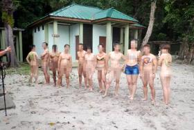 Screen grab from a video showing the group  in the buff frolicking on a beach in Penang.