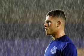 Everton midfielder Ross Barkley has been ruled out for up to two months after injuring his knee in training.