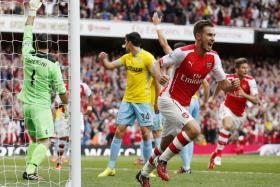 Aaron Ramsey celebrates after scoring the late winner for Arsenal against Crystal Palace.