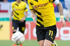 Marco Reus in action for Borussia Dortmund in the first round of the German Cup.