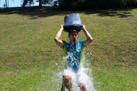 George Young took up the Ice Bucket challenge and tagged Prime Minister Lee Hsien Loong.