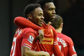 POSITIVES: Raheem Sterling and Daniel Sturridge (above) showed signs of a flourishing partnership, while Dejan Lovren displayed promise in their game against Southampton.