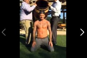 David Beckham is about to be doused after accepting an ice bucket challenge from Ryan Seacrest to raise awareness for ALS.