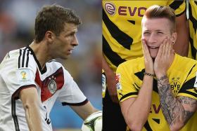Germany stars Thomas Mueller and Marco Reus have reportedly turned down moves to Manchester United.