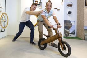 Sunny Chuah (right) and Dutchman Daniel Heerkens (left) with their GreenChamp Bike, a balance bike for tykes aged 18 months to five years.