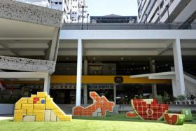 A pop-up play space at Waterloo Centre featuring 3D jigsaw puzzles modelled after old-school playgrounds in Singapore along Queen Street. The temporary exhibition is organised by the Urban Redevelopment Authority.