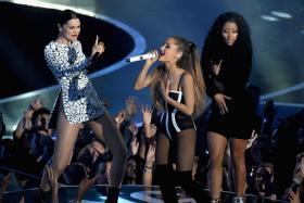 Nicki Minaj (right) handles her wardrobe malfunction at the MTV Video Music Awards like a pro.