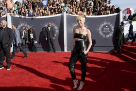 Miley Cyrus who won the Video of the Year award for Wrecking Ball sent a homeless youth to accept the award.