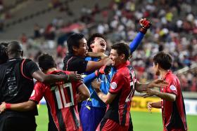 South Korea's FC Seoul goalkeeper Yu Sang-Hun celebrates after brilliantly saving three penalties, as the team beat South Korea's Pohang Steelers during the AFC Champions League quarter final football match in Seoul.