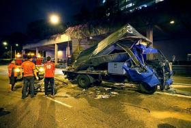 CRASHED: (Above)The mangled heap that was the lorry involved in the initial crash with a Malaysian tipper truck.