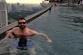 It sure seems like Australian actor Hugh Jackman misses Singapore as he shares #tbt (Throwback Thursday) picture on Instagram of him in the MBS infinity pool while he was in town for X-Men: Days of Future Past premiere.
