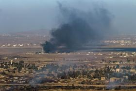 Smoke rise from the Syrian village of Quneitra, after Syrian rebels, including Al-Qaeda's affiliate Al-Nusra Front, seized control of the Syrian crossing with the Israeli-occupied Golan Heights.