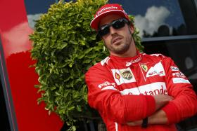 Fernando Alonso has little hope of success at this week's Italian Grand Prix, but he has rejected persistent speculation that he is set to move teams next year.