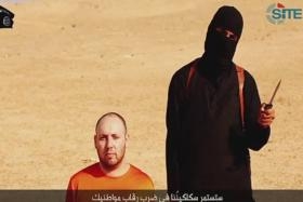 The Islamic State released a video purporting to show the beheading of Sotloff, a monitoring service said on Tuesday, as the militant group raised the stakes in its confrontation with Washington over U.S. air strikes on its fighters in Iraq.