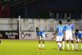 POOR CUP RUN: The LionsXII players feeling dejected after their Malaysia Cup campaign came to an end with just one win in six games.