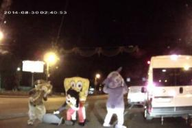 In a bizarre road range incident, Spongebob Squarepants, Mickeymouse and two other cartoon characters start beating up a man.