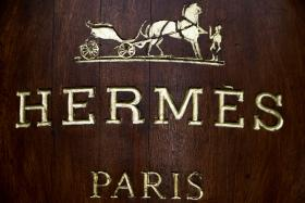 A file picture shows the Hermes logo above the facade of a shop in Paris.