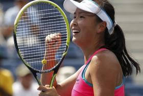 Chinese tennis player Peng Shuai celebrates her win over Switzerland's Belinda Bencic during their quarter-final match at the 2014 US Open.