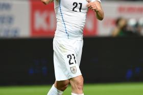 Edinson Cavani celebrates after scoring Uruguay's first goal against Japan on Friday.