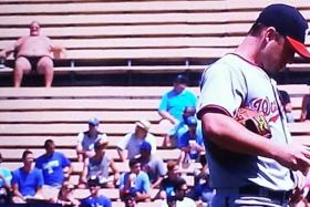A member of the crowd at a baseball game between the Los Angeles Dodgers and the Washington Nationals was caught on TV in just his shorts, apparently sunbathing.