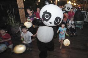 Kai Kai and Jia Jia celebrated their birthdays with a party at River Safari on Friday.