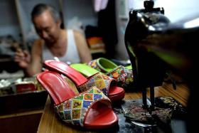 Footwear by hand