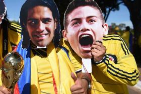 Colombian fans wearing masks of Radamel Falcao and James Rodriguez at the World Cup. Monaco supporters were angered by the departures of the two players, prompting them to demand a refund of their season tickets.