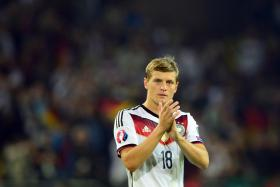 Germany's midfielder Toni Kroos applauds after the UEFA Euro 2016 Group D qualifying match of Germany vs Scotland on Sept 7, 2014 in Dortmund.