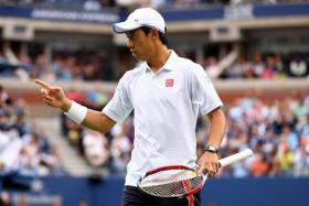 Kei Nishikori of Japan gestures against Marin Cilic of Croatia during their men's singles final match at the 2014 US Open.
