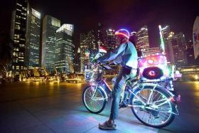 BLING: Judge Simon Ker said Mr Wong Chek Poh's photo showed the lively mood of the CBD which complemented the colourful bicycle.