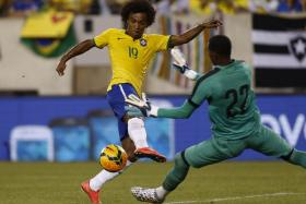 Willian prods home Brazil's winner against Ecuador.