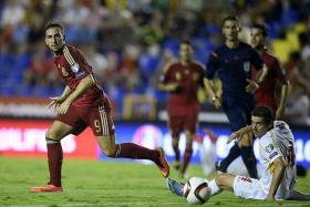 A BETTER FIT? Paco Alcacer's (above, left) more subtle style could be more suited for Spain's tiki-taka approach than the brusque Diego Costa.
