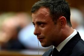 An emotional Oscar Pistorius is seen in the dock as judgment is handed down in his murder trial at the High Court in Pretoria.