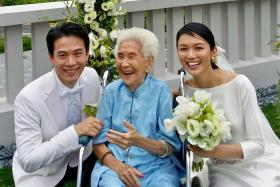 SMILES: The groom and bride with Mr Daniel Yun's mother.