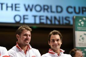 Switzerland's players Stan Wawrinka (L) and Roger Federer attend on September 11, 2014 the draw ahead of their tennis Davis Cup semi-final matches against Italy in Geneva.