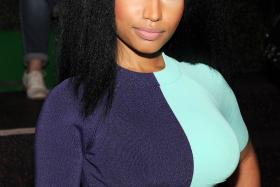 Award-winning US singer-songwriter Nicki Minaj was rejected by her former high school's principal after the 31-year-old singer proposed to give an inspirational talk to the current students of the performing arts school.