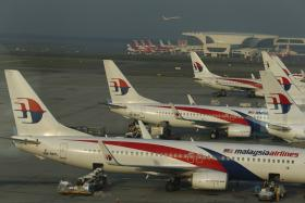A Malaysia Airlines flight enroute from Kuala Lumpur to Hyderabad, India was forced to turn back after an auto-pilot defect.