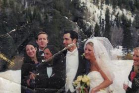 A college professor has been trying to find the owner of a wedding photo found in the rubble of the World Trade Center on September 11, 2001.