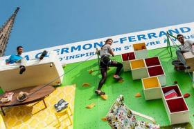 To promote the opening of its 30th store in France, Ikea built an apartment showroom into a vertical rock-climbing wall.