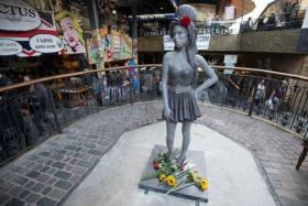 A life-size bronze statue of Amy Winehouse was unveiled in London on Sunday to mark what would have been the British singer-songwriter's 31st birthday.