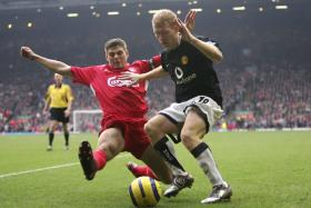 Ex-Manchester United midfielder Paul Scholes (in black) believes Steven Gerrard's Liverpool are dark horses to win this year's Champions League title.